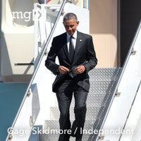 The president Walking off of Air Force One